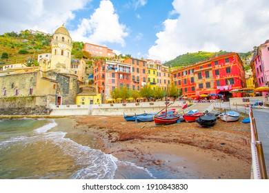 Vernazza in cinque terre on the mountain near mediterranean sea in liguria - Italy. Sunny cloudy sky. Traditional italian architecture