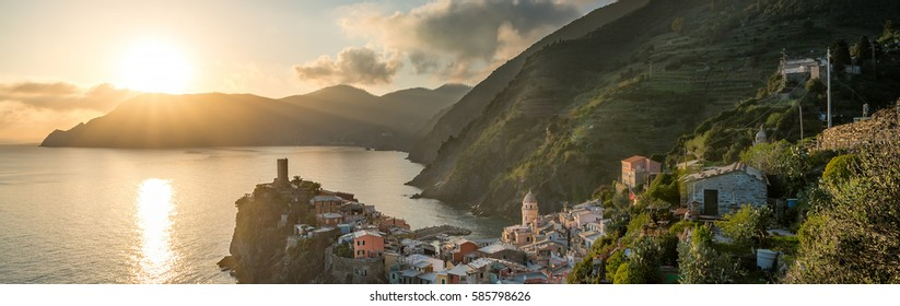 Vernazza colorful village fishing village, seascape vineyard resort valley on cliff rocks in Five lands, panoramic view on dramatic red sunset sky. Cinque Terre National Park, Liguria Italy Europe.
