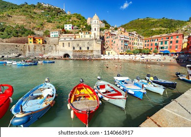 Vernazza. Fantastically beautiful coastal village Vernazza in Italy. Vernazza is one of the five city of famous national park Cinque Terre, UNESCO world heritage list. Boat at foreground in old port.