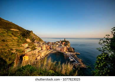 Vernazza fisherman village at sunset. Vernazza is one of five famous colorful villages of Cinque Terre in Italy, suspended between sea and land on sheer cliffs. Liguria, Italy