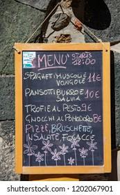Vernazza, Italy - 09/29/2018: A Menu for a Café Along the Streets of Vernazza