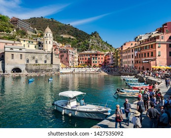 Vernazza, Italy - April 20, 2019 Frontal view of the main square and port of the town of Vernazza in Cinque Terre Region