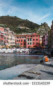 Vernazza, Italy - April 2019: The port of Vernazza, in the Cinque Terre in Liguria, on a cloudy day