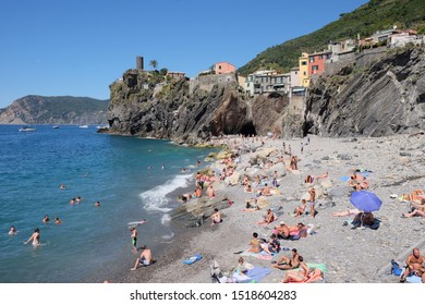 VERNAZZA, ITALY, August 2016: touristic trip. Travel view of Vernazza stone beach during the summer time. The image location is Cinque Terre in Liguria, Italy.