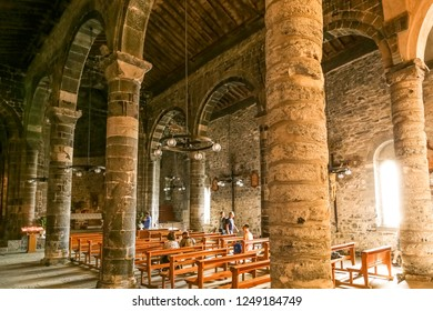 VERNAZZA, ITALY - AUGUST 22, 2014: Visitors, tourists inside of the medieval Santa Margherita church in Vernazza, Italy