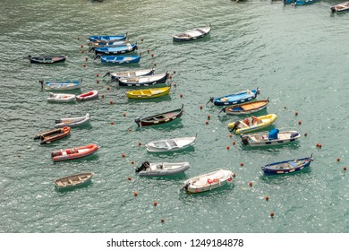 VERNAZZA, ITALY - AUGUST 24, 2014: Boats at harbour of Vernazza.