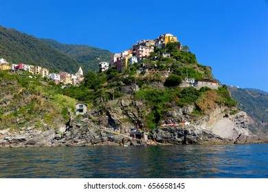 Vernazza, Italy colorful houses on a rocky hilltop above Mediterranean Sea on Cinque Terre coast