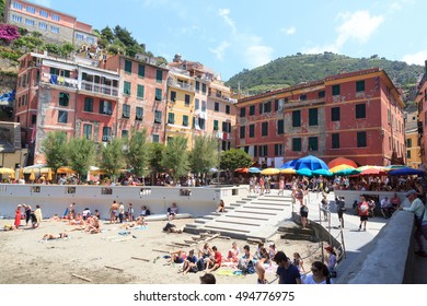 Vernazza, Italy - June 26, 2016: Crowded village Vernazza with beautiful colorful houses. Vernazza is one of the five villages in Cinque Terre.