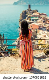 VERNAZZA ITALY - MARCH 2019 : Tourist looking at Vernazza village Cinque Terre National Park Liguria Italy - famous italian travel destination