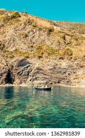 VERNAZZA, ITALY - MARCH, 2019: Tourists boat enter in the port of Vernazza, Cinque Terre (Italian Riviera Liguria), Italy - famous italian travel destinations