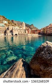 VERNAZZA, ITALY - MARCH, 2019: Tourists at Vernazza, Cinque Terre National Park (Italian Riviera Liguria), Italy - famous italian travel destinations