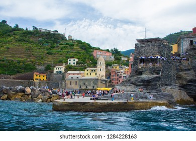 Vernazza, Italy - May 28, 2018: Vernazza, one of the five small towns in the Cinque Terre national Park. View from the excursion ship. Amazing colorful small town located in the mountains near sea.