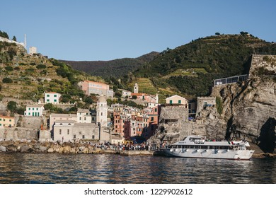 Vernazza, Italy - October 30, 2016: Tour boat approaching Vernazza, one of Cinque Terre villages, on a bright day. Cinque Terre was included as a UNESCO World Heritage Site in 1997.
