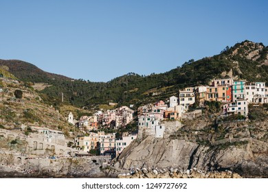 Vernazza, Italy - October 30, 2016: View of Vernazza, one of Cinque Terre villages, on a bright day. Cinque Terre was included as a UNESCO World Heritage Site in 1997.