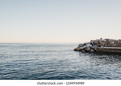 Vernazza, Italy - October 30, 2016: View of blue waters of Mediterranean Sea from Vernazza, Cinque Terre, Italy. Cinque Terre was included as a UNESCO World Heritage Site in 1997.