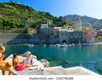 Vernazza, Italy - September 14, 2019: People resting at beach in Vernazza town, Cinque Terre National Park