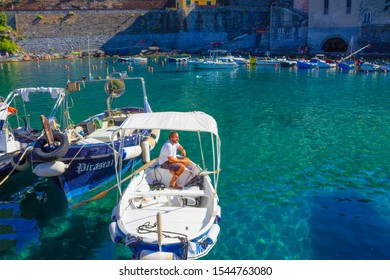 Vernazza, Italy - September 14, 2019: Boat driver at beach in Vernazza town, Cinque Terre National Park