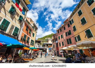 Vernazza, Italy - September 2015: Tourists walking around and eating at outdoor patios of restaurants in Vernazza, one of the five villages that make up Cinque Terre