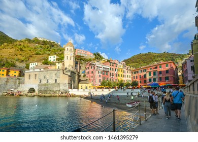 Vernazza, Italy - September 24 2018: Local Italian children play soccer on the sandy beach in the harbor of Vernazza, Italy, part of the Cinque Terre World Heritage site on the Ligurian Coast