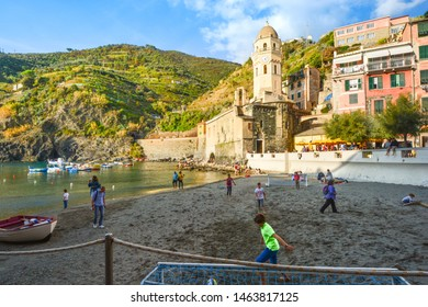 Vernazza, Italy - September 24 2018: Local Italian children play soccer on the sandy beach in harbor of Vernazza, Italy, part of the Cinque Terre World Heritage site on the Ligurian Coast
