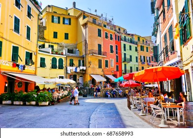 Vernazza, Italy - September 9 : View of the colorful houses along the main street on a sunny day in Vernazza, Italy on September 9, 2016. Vernazza is one of the five famous Cinque Terre villages.
