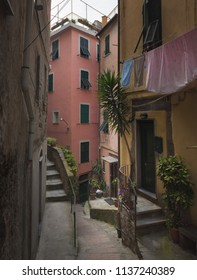 Vernazza, Italy - View of the colorful houses along the street on a sunny day in Vernazza, Italy. Vernazza is one of the five famous Cinque Terre villages.