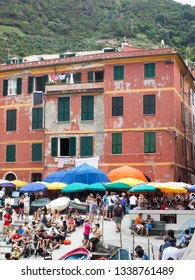 VERNAZZA, ITALY-SEPTEMBER: Tourists are seen by historic building in Vernazza, Cinque Terre, Italy in September 2018.