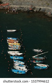 Vernazza, La Spezia, Italy About 9/2018.Typical colored fishing boats, Gozzo type, anchored in the harbor of Vernazza in the Cinque Terre. Top view of the path.