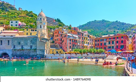 Vernazza, La Spezia, Italy - July 2, 2019:  Panoramic view of the beach and waterfront in Vernazza town, Cinque Terre National Park