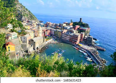 Vernazza, Liguria, Italy - 2018: Panoramic view of the city of Vernazza (Cinque Terre National Park) with church and boats