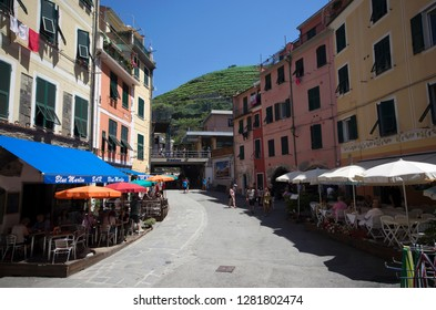 Vernazza, Liguria / Italy - June 23 / 2016: Tourists are resting at caffes at the town centre of Vernazza