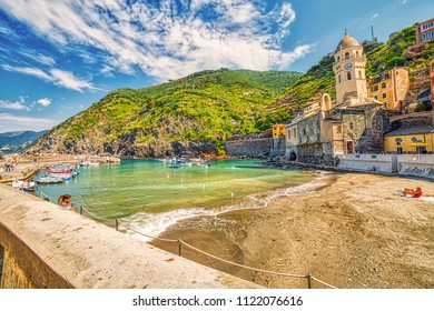 VERNAZZA (SP), ITALY - JUNE 18, 2018: tourists are resting and sunbathing on the beach of Vernazza