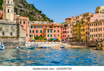 VERNAZZA (SP), ITALY - JUNE 20, 2018: tourists are having fun and sunbathing in Vernazza, stunning village of Cinque Terre National Park in Italy