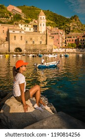 Vernazza village, aerial view on sunset, Seascape in Five lands, Cinque Terre National Park, Liguria Italy Europe, woman at harbor front watching the villag Vernazza