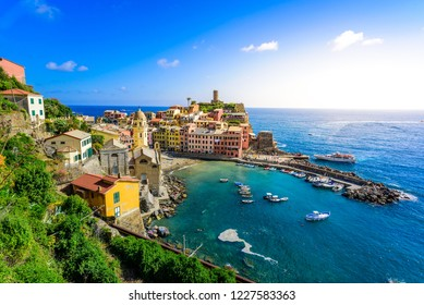 Vernazza - Village of Cinque Terre National Park at Coast of Italy. Beautiful colors at sunset. Province of La Spezia, Liguria, in the north of Italy - Travel destination and attractions in Europe.