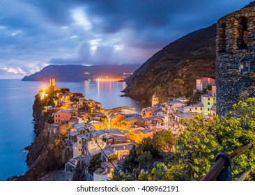 Vernazza village, Ocean Rugged Coast Harbour, Castello Doria Aerial View Panorama Scenic Postcard view under Dramatic Sky Blur Cloud at night in Summer. Cinque Terre National Park, Liguria Italy