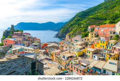 Vernazza village with typical colorful multicolored buildings houses, Castello Doria castle on rock, green hills and Genoa Gulf, Ligurian Sea, National park Cinque Terre, La Spezia, Liguria, Italy