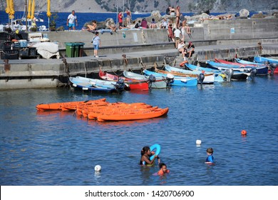 VERNAZZA,LE CINQUE TERRE,LIGURIA.ITALIA. August 2017  Children bathing on Vernazza beach in summer