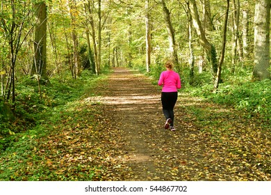 Verneuil sur Seine; France - october 30 2016 : jogger in the forest in the west of the city