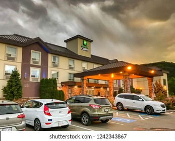 VERNON, BC, CANADA - JUNE 2018: Exterior view of the front of the Holiday Inn Express hotel at dusk in Vernon, BC.