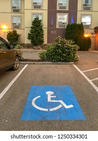 VERNON, BRITISH COLUMBIA, CANADA - MAY 2018: Symbol marked on the surface of a parking bay reserved for disabled persons at a hotel in Vernon, British Columbia.