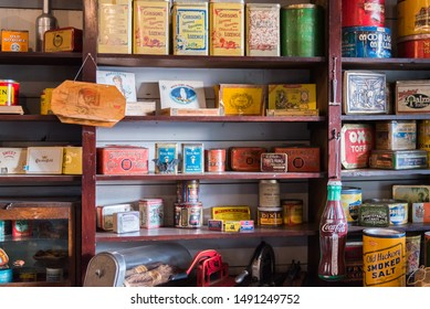 Vernon, British Columbia/Canada - October 23, 2016: tins of vintage dry goods displayed on shelves in the general store at O'Keefe Ranch, a popular tourist attraction