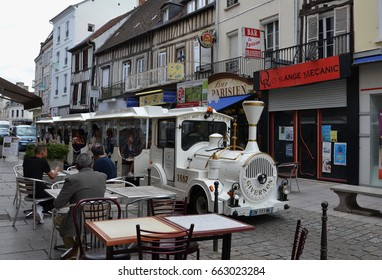 VERNON, FRANCE - AUG 12:  The Givernon train travels through Vernon, France on on August 12, 2016. It transports tourists from the Vernon train station to Giverny.