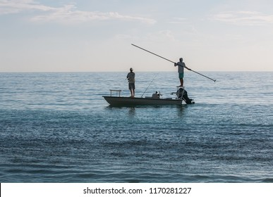 Vero Beach, Florida -  August 18, 2015.  Two young fishermen out early on the small boat to try their luck in Vero Beach, Florida.