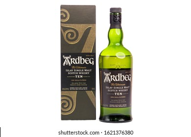 Vero Beach, Florida; USA; Dec. 11, 2019. A (750ml) size bottle of peated Islay Singe Malt Scotch Whisky and its decorative case are photographed on a white background. Wide angle with copy space.