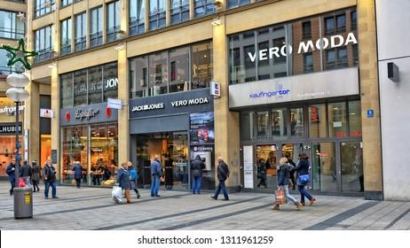 e100b14b Vero moda store. Shopping in Bavaria. Women carry bags. People walk in a