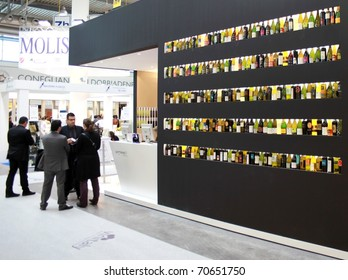 VERONA - APRIL 08: People visit production and tasting wine stands at regional at Vinitaly, international wine and spirits exhibition April 08, 2010 in Verona, Italy.