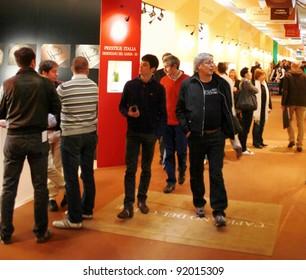 VERONA - APRIL 08: People visit wine tasting areas at Italian regional pavilions during Vinitaly, international wine and spirits exhibition April 08, 2010 in Verona, Italy.