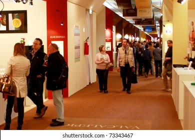 VERONA - APRIL 08: Visiting wine production stands at Vinitaly, international wine and spirits exhibition April 08, 2010 in Verona, Italy.