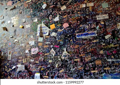VERONA - AUGUST 16, 2018: The wall full of messages from lovers in Juliet house on August 16, 2018 in Verona, Italy
